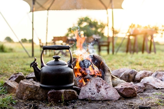 Dreamy camp fire at Singita Explore