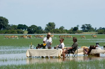 A blissful and surprising bush dining venue at Jao camp in the Okavango Delta