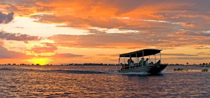 Spectacular sunset during a river safari at Sanctuary Chobe Chilwero in Botswana